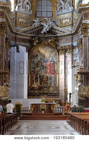 ROME, ITALY - SEPTEMBER 02: Main altar depicting the Saints Ambrose and Charles Borromeo with the Virgin and Jesus, Basilica dei Santi Ambrogio e Carlo al Corso, Rome, Italy on September 02, 2016.