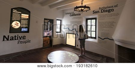 SAN DIEGO, CALIFORNIA, JUNE 10. Presidio Park on June 10, 2017, in San Diego, California. A Woman Browses Exhibits at the Junipero Sierra Museum in Presidio Park, San Diego.