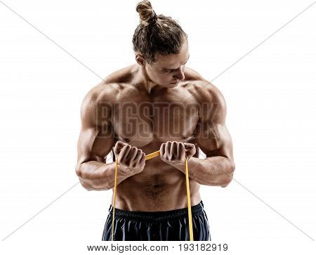 Close up of athletic man performing exercises with a resistance band. Photo of strong male shirtless isolated on white background. Strength and motivation.