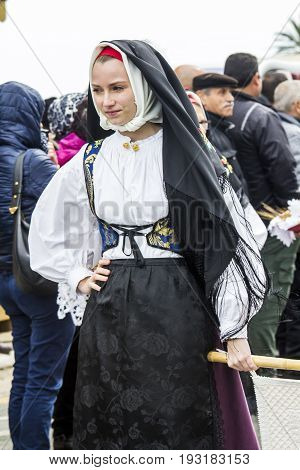 MURAVERA ITALIA - APRIL 2 2017: 45 Citrus festival - portrait of a beautiful woman of the folk group pro-loco of Gonnosfanadiga - Sardinia