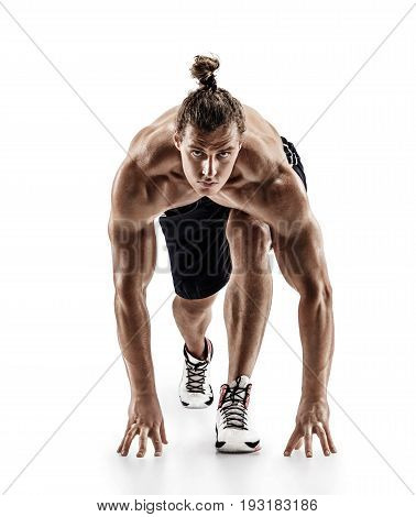 Athletic man doing stretching and warming up exercises. Photo of muscular male isolated on white background. Strength and motivation