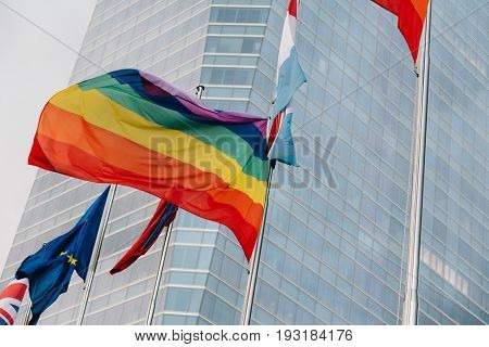 Madrid Spain - June 25 2017: Low angle view of Cuatro Torres Business Area CTBA Four Towers Business Area a business district. Flags waving against buildings during Madrid World Pride 2017