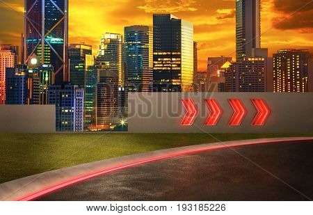 Asphalt road with arrow fluorescent light signs and night scene city skyline background