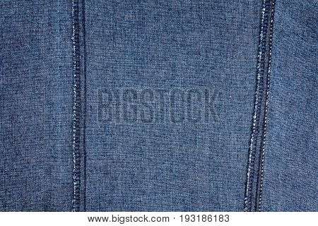 Wrong side of jeans fabric with back seams