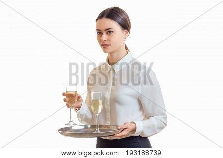 Beautiful young waitress in uniform with trey in hands isolated on white background