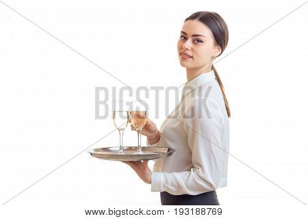 lovely young waitress with trey in hands in uniform looking at the camera isolated on white background