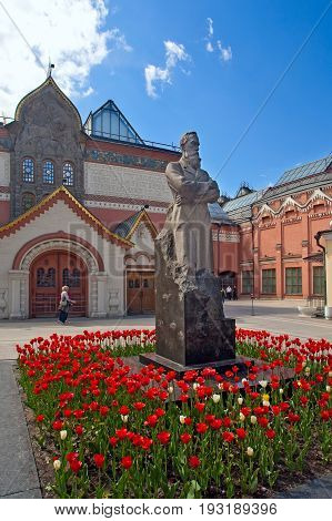 Moscow Russia - May 27 2017: Pavel Tretyakov monument and Tretyakov Gallery building in Lavrushinsky Lane in Moscow. Tretyakov Gallery is art museum having collection of Russian art.