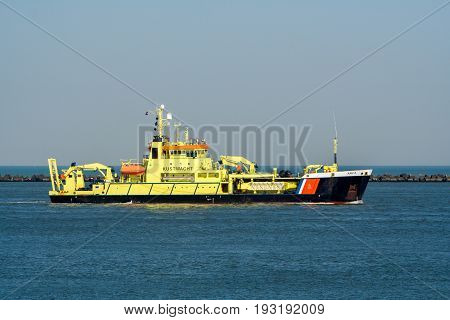 ROTTERDAM - MAR 8 2011: Dutch Coast Guard ship entering the Port of Rotterdam