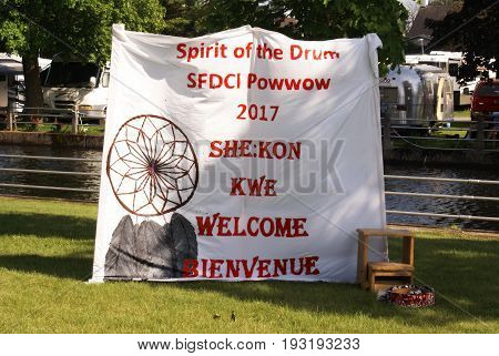 SMITHS FALLS ON JUNE 10 2017 EDITORIAL IMAGE SERIES OF NATIVES POWWOW CEREMONY with this image focused on the natives ceremony information banner displayed.