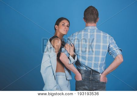 Man With Back In Shirt And Girl In Jeans Jacket