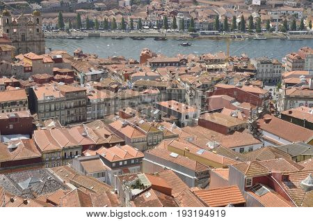 PORTO, PORTUGAL - AUGUST 7, 2015: Tile roofs the Douro river and the riverbank of Gaia seen from Clerigos Tower in Porto Portugal