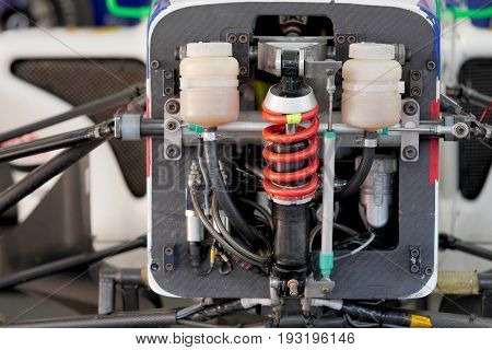 close up of shock absorber of racing car