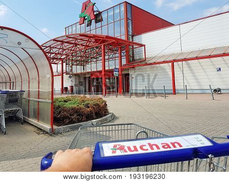 Nowy Sacz Poland - June 25 2017: Exterior view of the Auchan Hypermarket. Auchan is a French international retail group and multinational corporation headquartered in Croix France.