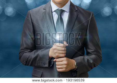 Businessman Holding Microphone .