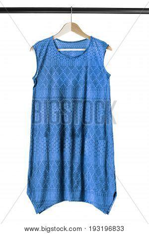 Blue oversized sleeveless tunic on wooden clothes rack isolated over white