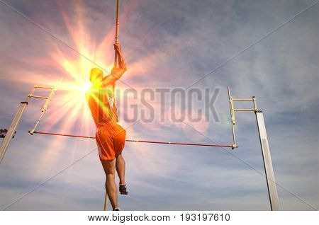 Pole vaulted taking off, low angle view
