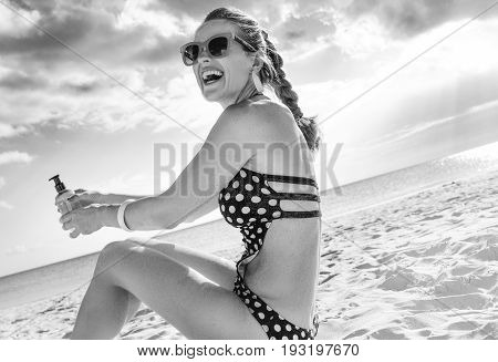 Cheerful Healthy Woman In Swimwear On Seacoast With Spf