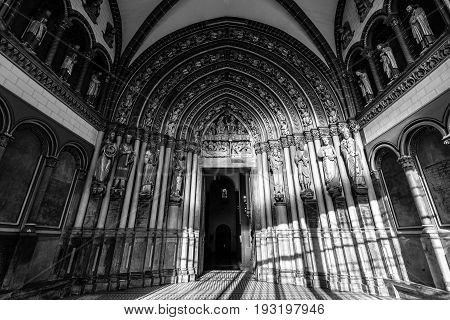 MAASTRICHT NETHERLANDS - JANUARY 09 2015: Interior of Basilica of St. Servatius. South portal. Black and white. The Basilica of St. Servatius is a oldest Roman catholic church the Netherlands.