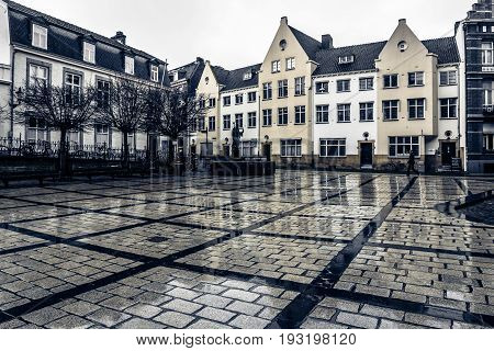 MAASTRICHT NETHERLANDS - JANUARY 16 2016: One of the squares of the city after the rain. Black and white. Toning. Maastricht is the oldest city of the Netherlands and the capital city of the province of Limburg.