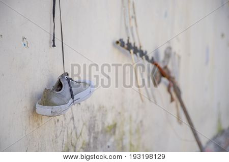 A gray shoes hanging outside of the old prison Penal Garcia Moreno in the city of Quito.
