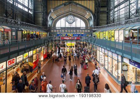 August 05, 2016: People and shops in the main train station