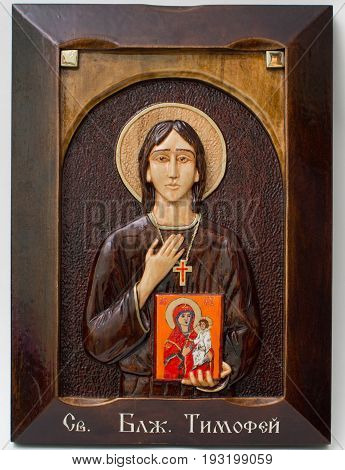 Carved icon from wood handmade. Holy timothy.
