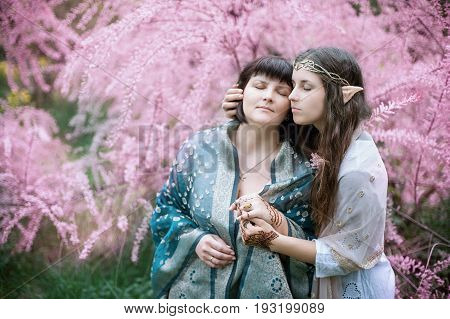 fairy tale girls. Portrait of mystic elven mother and daughter. Cosplay character. Drawing mehendi