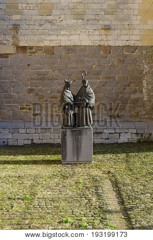 MAASTRICHT NETHERLANDS - JANUARY 16 2016: Statues of Monulfus and Gondolas Maastricht bishops in front of Basilica of St. Servatius by sculptor Jef Courtens. The Basilica of St. Servatius is a oldest Roman catholic church the Netherlands.