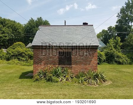small and old red brick house or storage shed