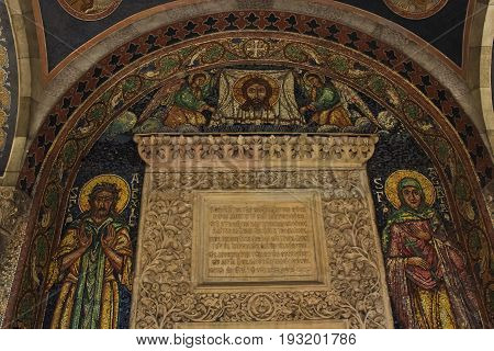 Bucharest, Romania - August 20, 2014: Ancient mosaic of Jesus Christ, Saint Agata and Saint Alexie and stucco of Holy Scripture in Stavropoleos Monastery in central Bucharest, Romania.