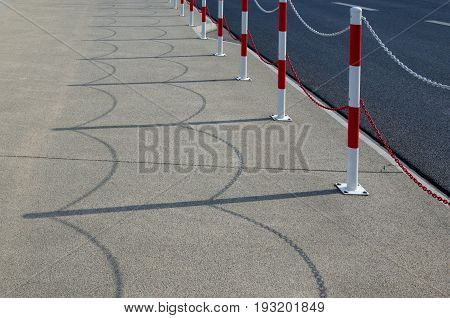 PAVEMENT - Barriers on the sidewalk and asphalt roadway