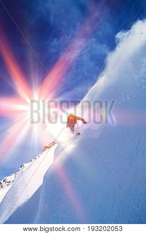Low angle view of man snowboarding on steep slope