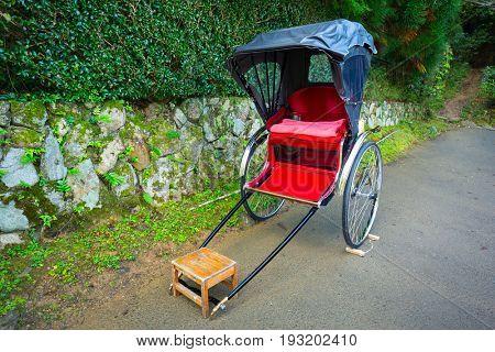 Japanese rickshaw at the bamboo forest of Arashiyama, Japan