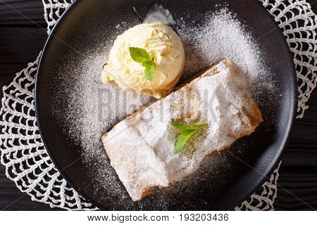 Homemade Apple Strudel With Vanilla Ice Cream And Mint Closeup On The Table. Horizontal Top View