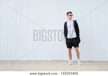 Young Fashionable Man On A Light Background