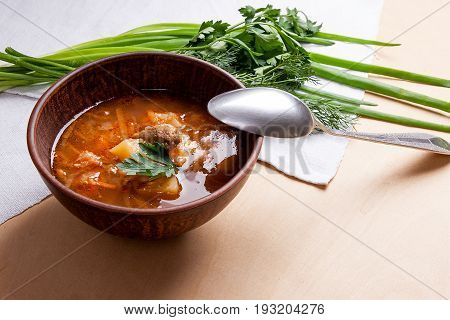Borsch - Traditional Ukrainian And Russian Red Beetroot Soup With Red Beets In Clay Bowl With Metal