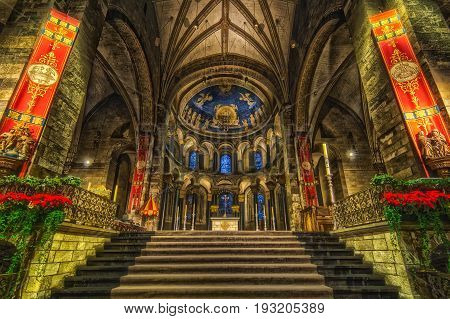 MAASTRICHT NETHERLANDS - JANUARY 13 2016: Interior of Basilica of Our Lady of the Assumption. The oldest church of the Netherlands. Construction started shortly after 1000 AD. Toning HDR.