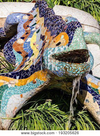BARCELONA, SPAIN - APRIL 15, 2017: Barcelona, Spain. Lizard mosaic sculpture in Park Guell