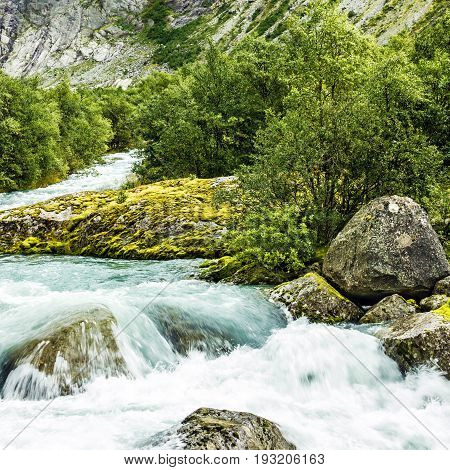 Spring water Briksdal Norway. Norwegian landscape in national park Jostedalsbreen.
