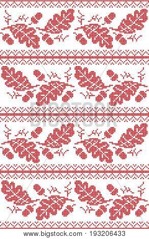Scandinavian and Norwegian folk inspired festive autumn seamless pattern in cross stitch with acorn, oak leaf and  ornaments in red and white