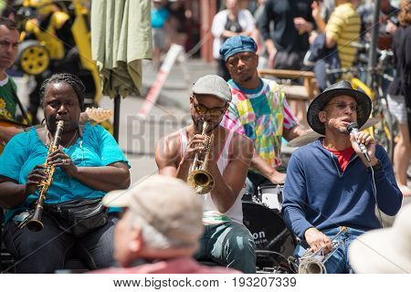 NEW ORLEANS - APRIL 13: In New Orleans, view of a jazz band plays jazz melodies in the street for donations from the tourists and locals passing by on April 13, 2014