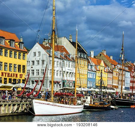 Copenhagen, Denmark - May 7, 2017: Yacht in Copenhagen sea front in summer. Nyhavn is old waterfront and canal district