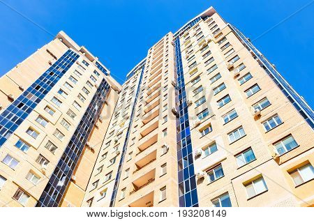 Samara Russia - April 27 2016: New tall apartment building against blue sky background