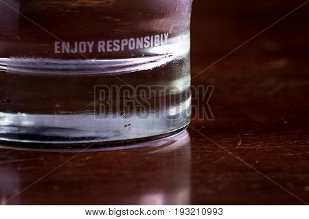 Enjoy Responsibly Edged On A Glass