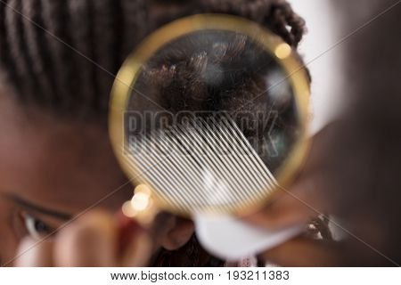 Close-up Of Dermatologist Looking At Patient's Hair Through Magnifying Glass poster