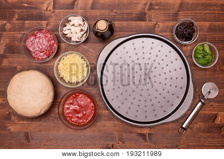 Pizza ingredients ready to be laid on the baking plate - top view