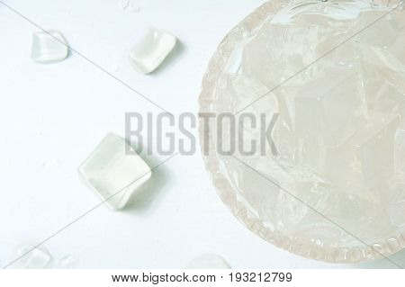 The ice cube in bucket on the table. Top view