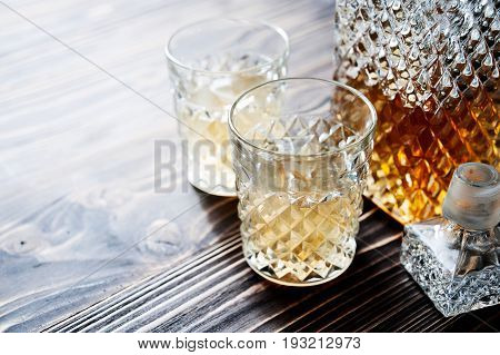 bourbon whiskey in glass on wooden background with copyspace