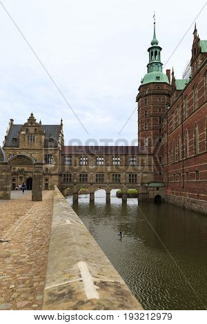 HILLEROD, DENMARK - JUNE 30, 2016: It is moat of the Frederiksborg Castle the residence of the Danish kings one of the masterpieces of the Scandinavian Renaissance.