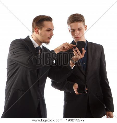 Two guys in suits using their smartphones